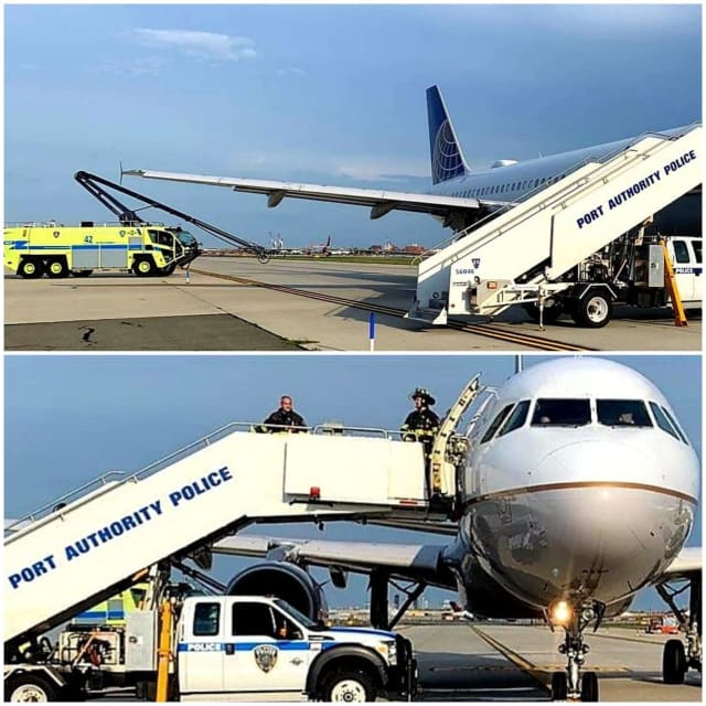 Port Authority police help passengers off a plane after it began leaking fuel during takeoff Monday at Newark airport.