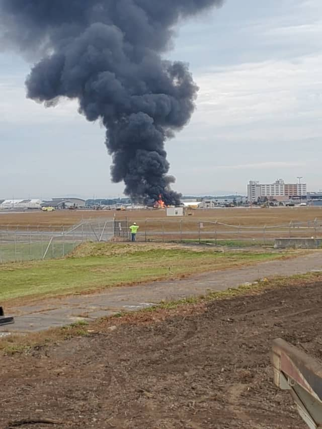 A plane crash at Bradley Airport has killed at least two people.