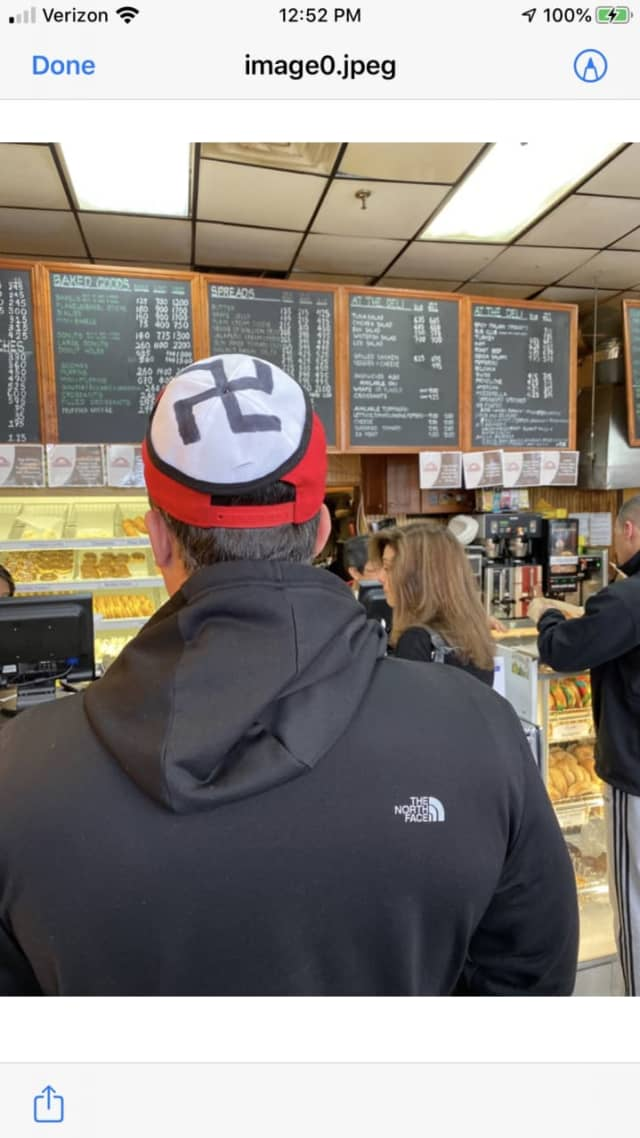 A man wearing a swastika on his hat was escorted off the property of a White Plains diner.