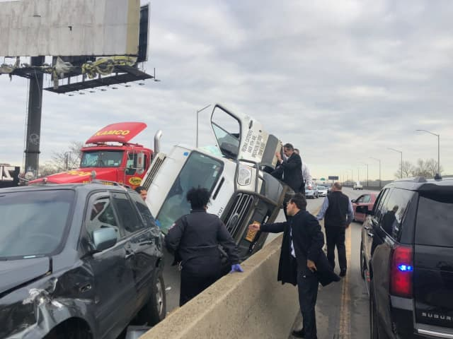 New York Gov. Andrew Cuomo helped a trapped passenger in a car on the Brooklyn Queens Expressway.