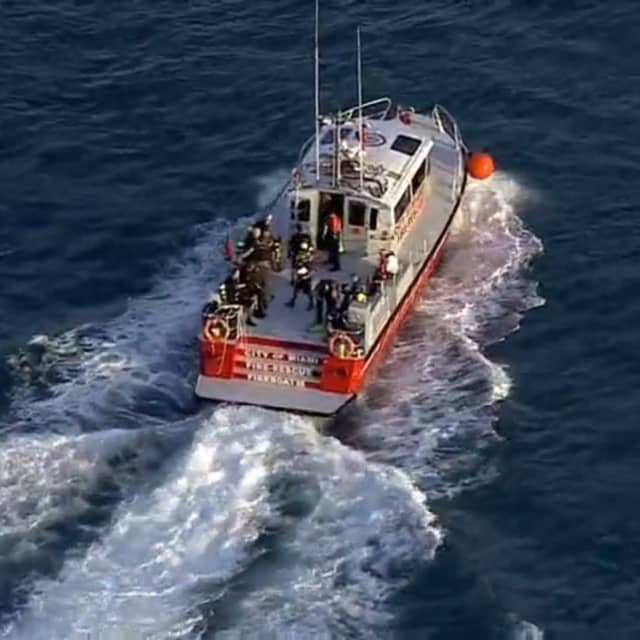 Miami Fire Rescue personnel search for a vehicle that fell off a ferry.