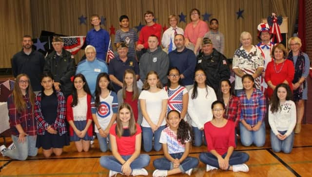 Students from Alfred S. Faust Honors English class and members of the East Rutherford VFW after the Veterans Day program.