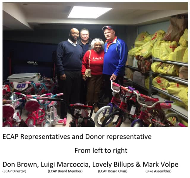Looking over the donated bicycles in Eastchester are, l.-r.: Don Brown, ECAP director; Luigi Marcoccia, ECAP board member; Lovely Billups, ECAP board chair; and Mark Volpe, bike assembler.