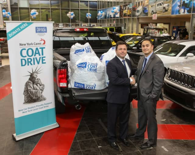 Eastchester Chrysler Jeep Dodge director Alan Katz with coats collected for New York Cares Coat Drive.