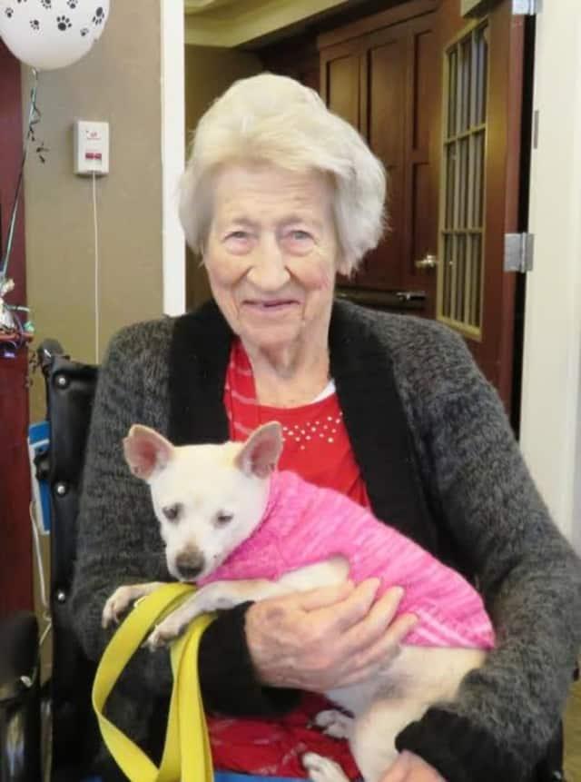 Heritage Manor resident Edna Hughes holds Tofu.