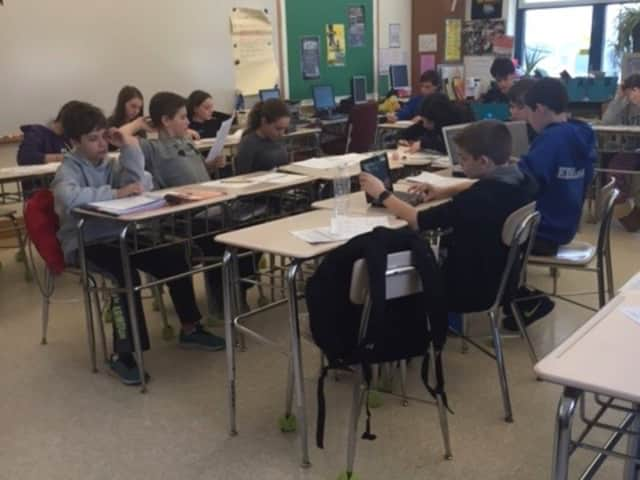 """Irvington Middle School eighth-graders in Dr. Jeffery Rieck's social studies class wrote """"letters to the editor"""" in response to the Apple v. the U.S. Federal Bureau of Investigation case over access to the iPhone used by a shooter in San Bernadino."""