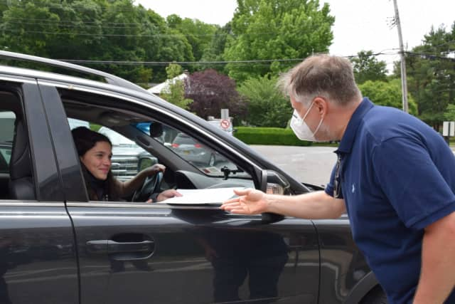 A Bronxville Middle School eighth-grader receives a certificate during a drive-through celebration Thursday, June 18.