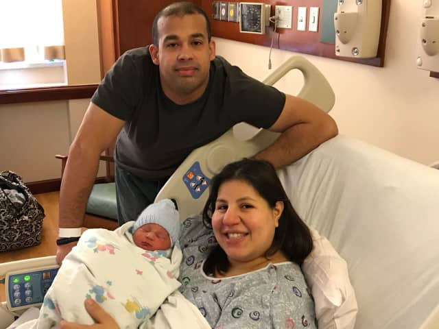 Emily and TJ Mederos of Port Chester, NY, welcome Mason Raphael Mederos, the first baby born in 2018 at Greenwich Hospital.
