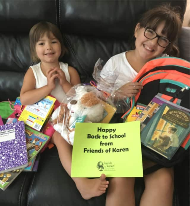 Emma and Mia show off their back to school supplies from Friends of Karen.