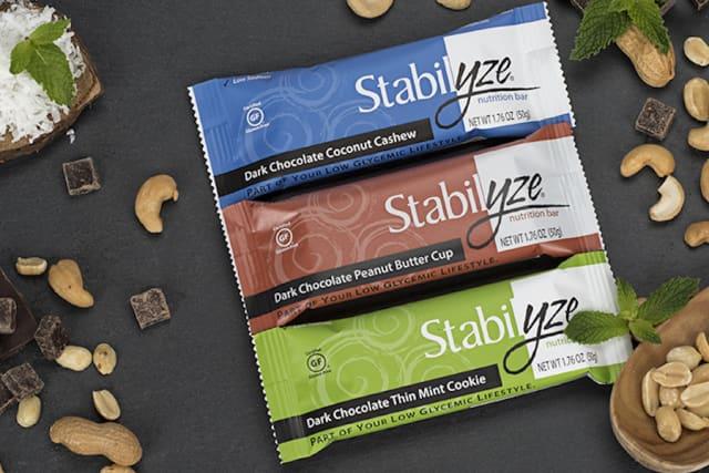 Stabilyze nutrition bars come in flavors including Dark Chocolate Coconut Cashew, Dark Chocolate Thin Mint Cookie and Dark Chocolate Peanut Butter Cup. Courtesy Stabilyze.