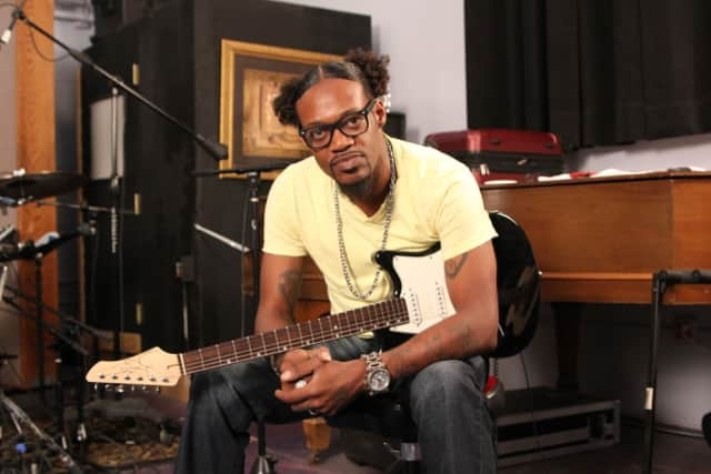Eric Gales holds a John Page Classic Ashburn guitar.