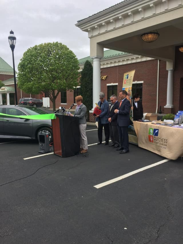 Erica Bacon discusses the many benefits of Zipcar at a recent launch ceremony in Beacon, while (L to R) Mary Kay Vrba, Dutchess Tourism, Inc. President & CEO, Mayor Randy Casale and Dutchess County Executive Marcus Molinaro look on.