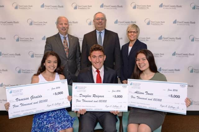Reyno A. Giallongo, Jr., Richard E. Taber and Karen M. Kelly of the First County Bank Foundation with winning students Vanessa Giraldo, Douglas Raigosa and Allison Tovar.