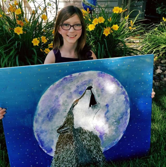 Ten-year-old Bria Shay Neff has raised more than $2,000 for the Wolf Conservation Center in South Salem.