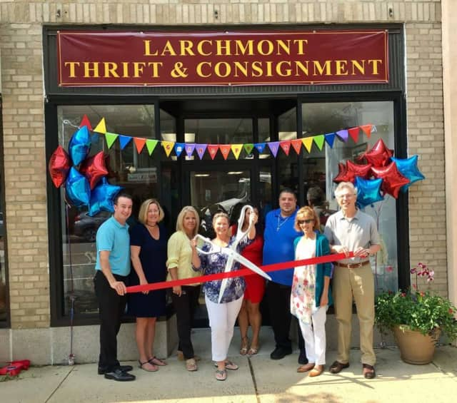 Larchmont Mayor Lorraine Walsh (with scissors), Village trustees and Chamber of Commerce board members at the ribbon cutting for Larchmont Thrift & Consignment.