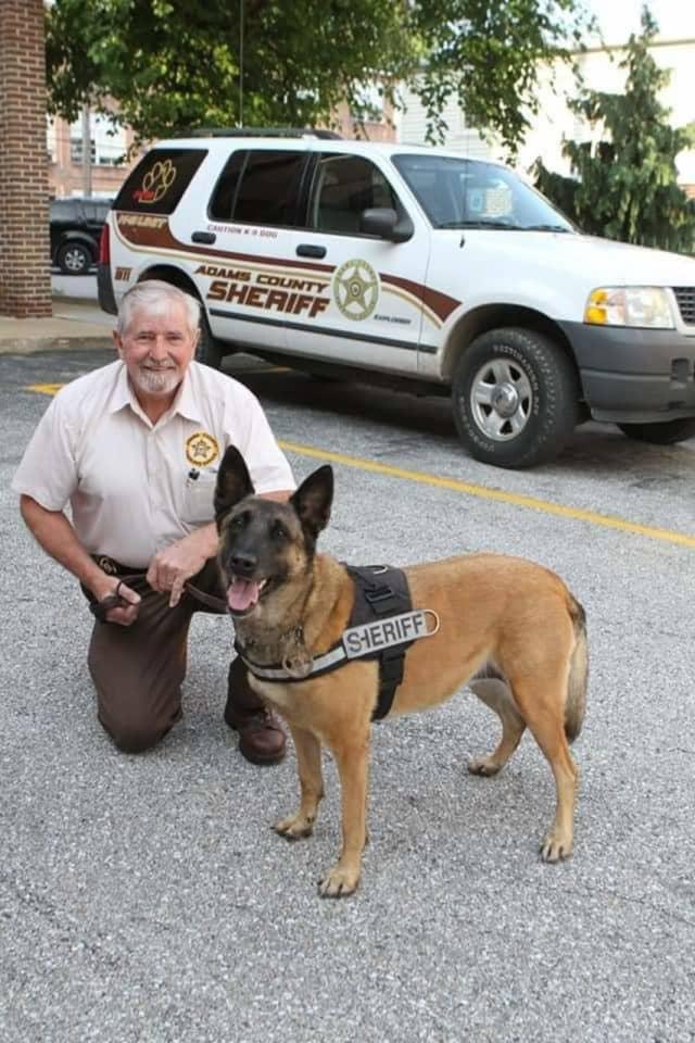 "Sheriff James Muller and K9 Deputy Alegra aka ""Leggy."""