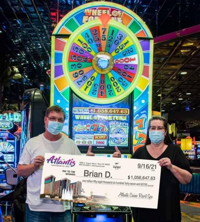 Brian D. won $1 million on a Wheel of Fortune slot machine at Atlantis Casino Resort Spa.