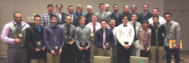Port Chester High School's varsity football team, coaches and district administrators at their Jan. 28 dinner at the Hilton Westchester in Rye. (Names are listed at the bottom of the sports article.)