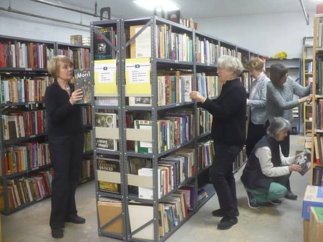 Members of the Friends of the Englewood Library sort and shelve books for their huge book sale April 29, 30, and May 1.
