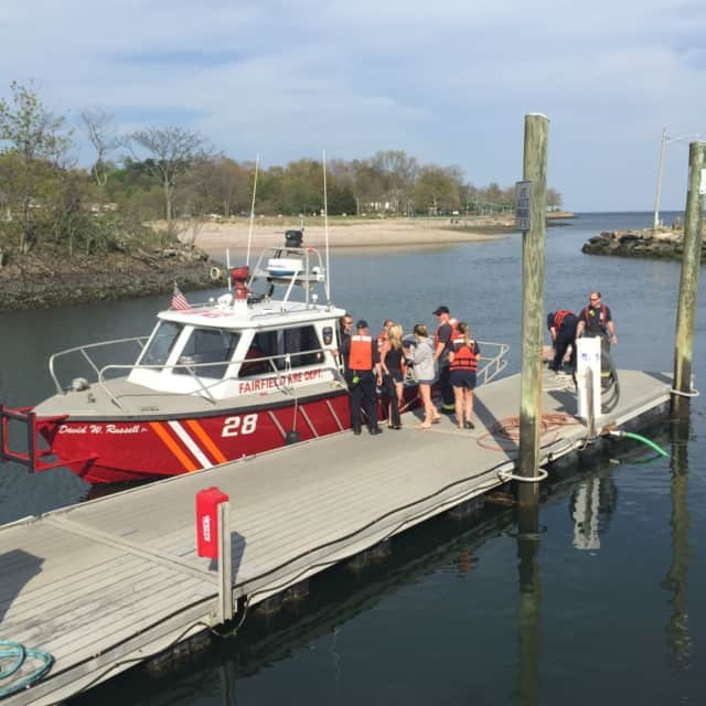 Three college students were rescued from Long Island Sound in Fairfield Monday afternoon.