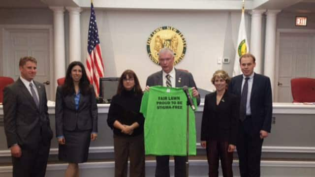 Fair Lawn officials and Mayor John Cosgrove present the Stigma Free T-shirt.