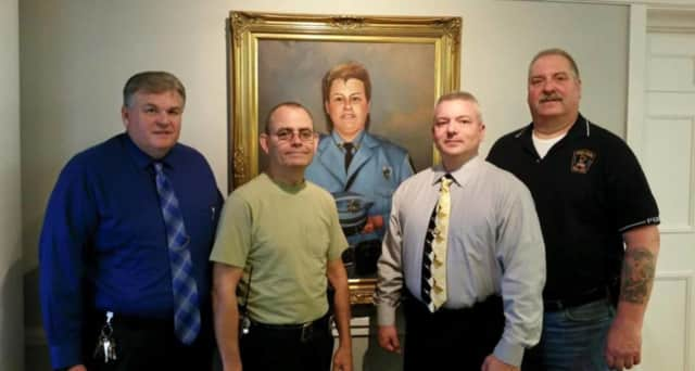 Standing before a portrait of slain colleague Mary Ann Collura: Detective David Boone, Officer Tim Franco, Detective Lt. Michael Uttel, Officer Louis Evangelista
