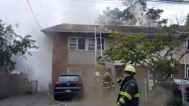 Firefighters battle a structure fire on Farley Drive in West Haverstraw Monday. Several families were left homeless and one firefighter had to be taken to the hospital.