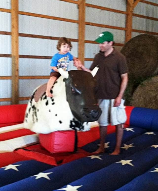 This little one gave the mechanical bull a try at the 2012 Farm Festival.