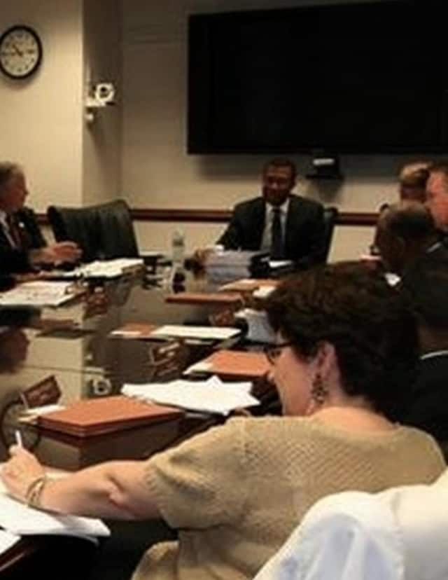 Federal Housing Monitor James Johnson (far end of table) at a meeting with the Westchester County Board of Legislators. In his last report, Johnson recommended legal action against seven Westchester communities over its housing laws.