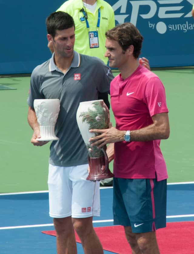 Novak Djokovic and Roger Federer during the trophy ceremony for the 2015 Western & Southern Open. They made the finals again this year, with Djokovic winning for the first time.
