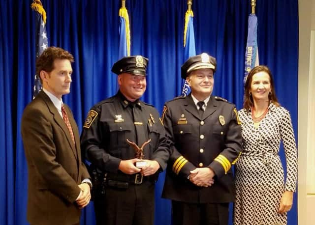 Officer Fedor and Chief Lombardo are joined by Assistant US Attorney Michael J. Gustafson and US Attorney Deirdre M. Daly.