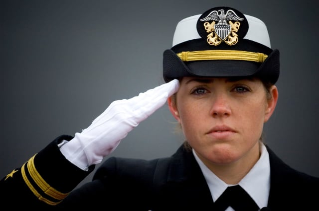 Ship navigator Shaina Hayden salutes.
