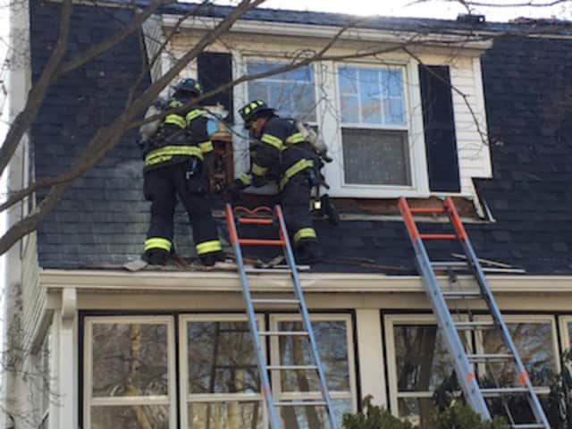 Firefighters in action at a Rockmere Avenue fire in Old Greenwich Thursday morning.