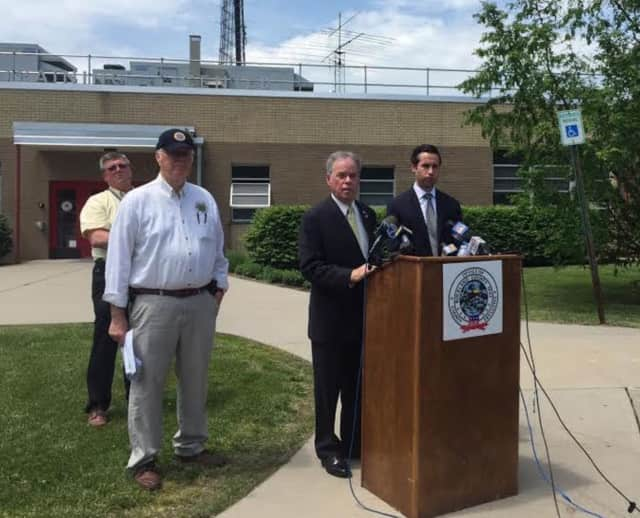 County Fire and Emergency Director Gordon Wren Jr., County Executive Ed Day, and Assemblyman Ken Zebrowski at a May press conference concerning inspections of private schools.