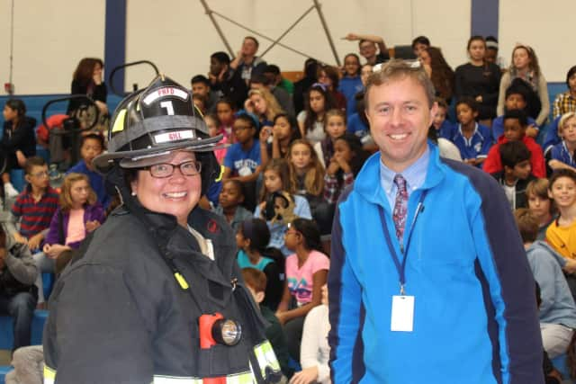 Firefighter Jennifer Gill Mahood and Interim Principal Adam Brown at a recent fire safety program at Pocantico Hills School.