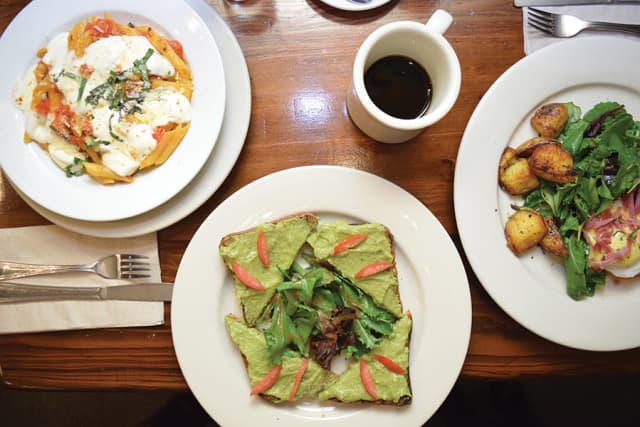 Irvington's Michael and Vivian Forte own and operate Pisticci, a cozy Italian eatery in the Morningside Heights section of Manhattan. Brunch selections there include, from left, Penne Pisticci; the restaurant's twist on the ubiquitous avocado toast; and Pisticci fiorentino. Photograph by Aleesia Forni.