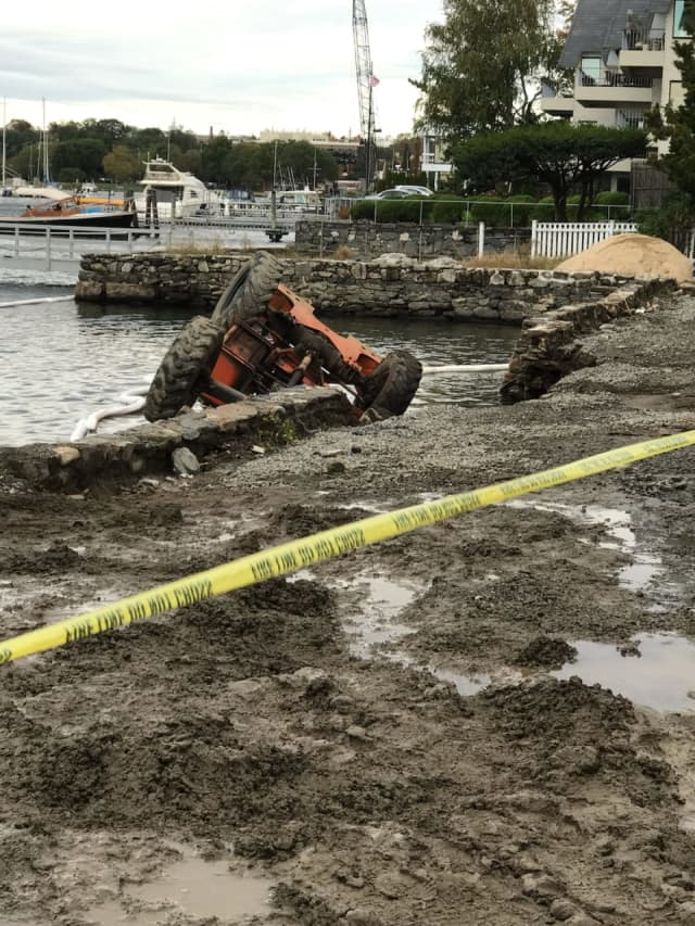 A forklift operator was a little wet, but unharmed after a seawall collapse sent the machine into the water.