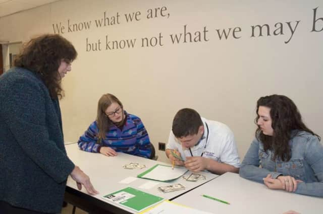 Professor Julie Norflus-Good observes  Ramapo College students work with a student from The Forum School.