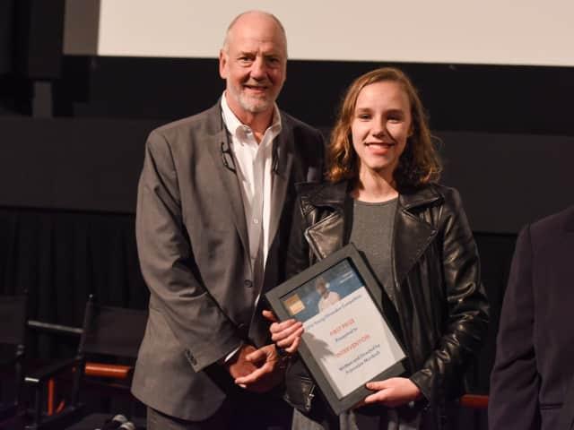 Francesa Murdoch receiving an award at the Mental Health Film Festival