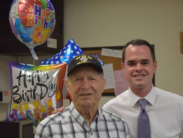 State Sen. David Carlucci, D-Rockland/Westchester, right, throws a party at his district offices in New City to celebrate Congers resident and World War II veteran Frank Morea's 103rd birthday.