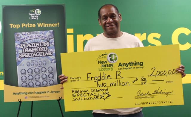 Freddie R. with a ceremonial check for his big win in 2017. He won big again playing scratch-offs last month