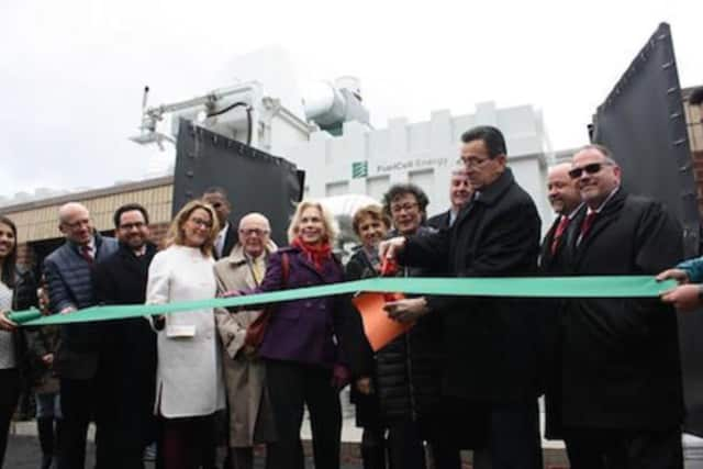 Gov. Dannel Malloy, Commissioner Robert Klee from the Department of Energy and Environmental Protection, and others participate in ribbon-cutting ceremony at Amity Regional High School for the commissioning of a fuel cell power plant in Woodbridge.