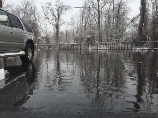 Nearly six inches of water had accumulated as of Tuesday morning in the back of the parking lot at Retro Fitness in Hackensack. Members and employees moved their cars to avoid water damage. Some returned back inside, afraid to flood their cars.