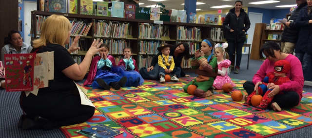 Denise Carrozza, children's librarian, leads story time at the Wanaque Public Library's Halloween party.