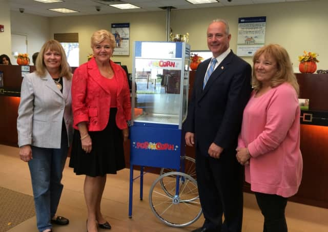 Saddle Brook officials accept a donated popcorn machine from Spencer Savings Bank. From left are Councilwoman Karen D'Arminio, Spencer Branch Manager Betty Shingelo, Mayor Robert White, and Council President Florence Mazzer.