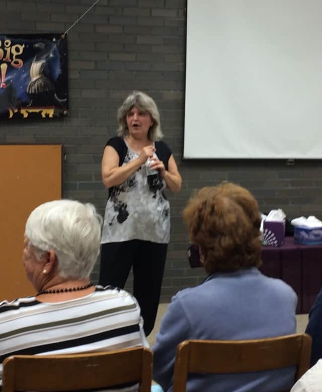 Shira leads a cold reading session at the Elmwood Park Public Library Wednesday, Oct. 7.