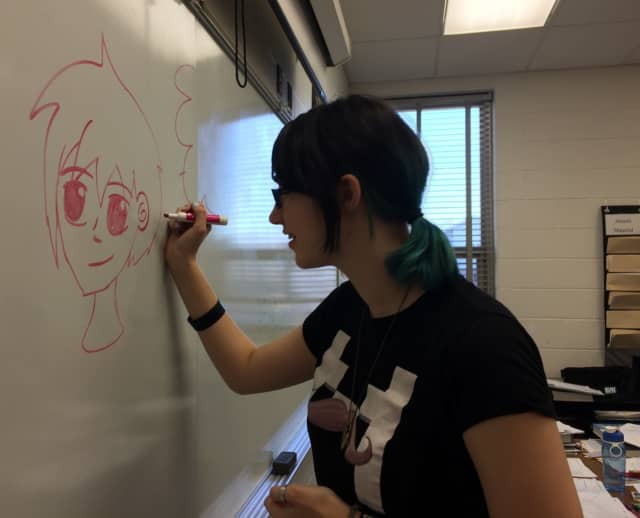 Elmwood Park sophomore Nicole Appel draws an anime style character on the board.