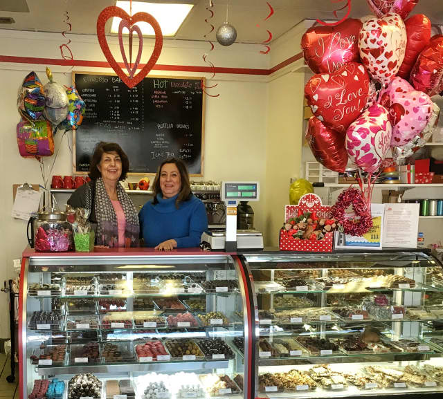 Helen Gould, left, and her sister, Diana Gould run Chocolate Rain Shop in Norwalk.