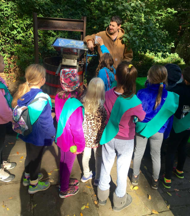 Instructor David Martin with Scarsdale Girl Scout Troop 2100 at apple press.