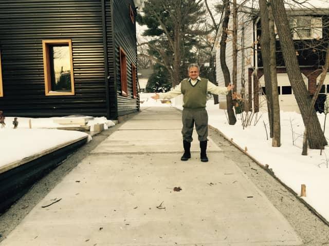 Raj Parikh standing on his heated driveway.